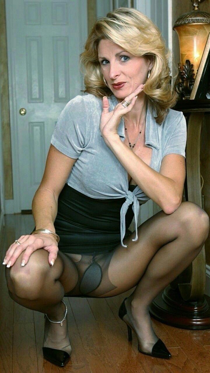 Elegant mature black nylon upskirt.