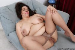 Chubby granny with tights pulled down.