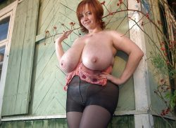 Huge tit mature in black tights.