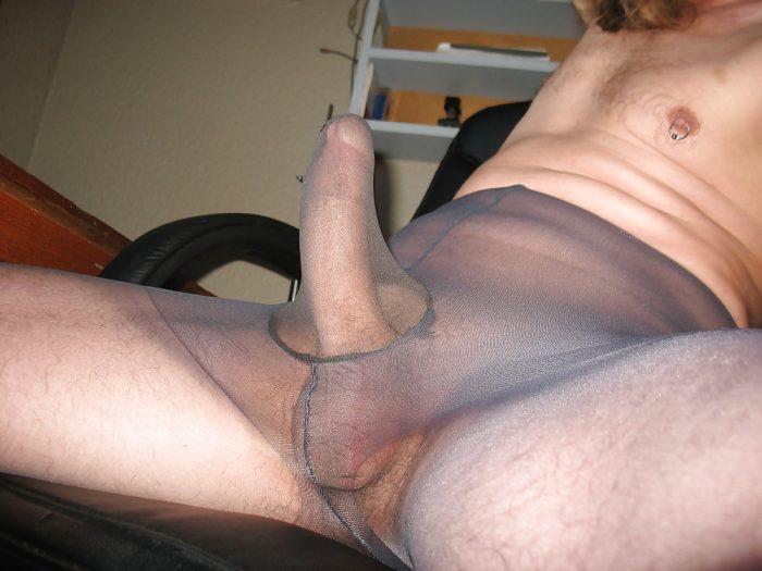 Full erection in gusset of dark tights.