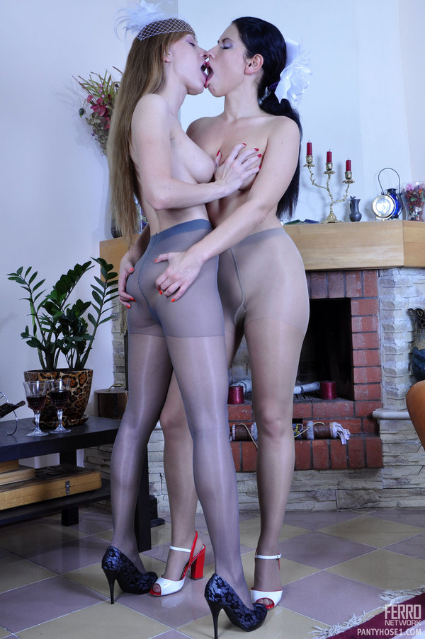 Two lesbians in tights kissing.
