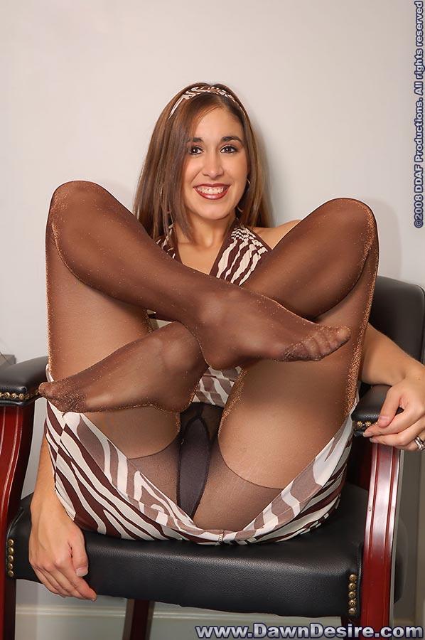 Sexy girl cross-legged in brown tights.