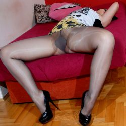 Sexy woman showing gusset in black tights.