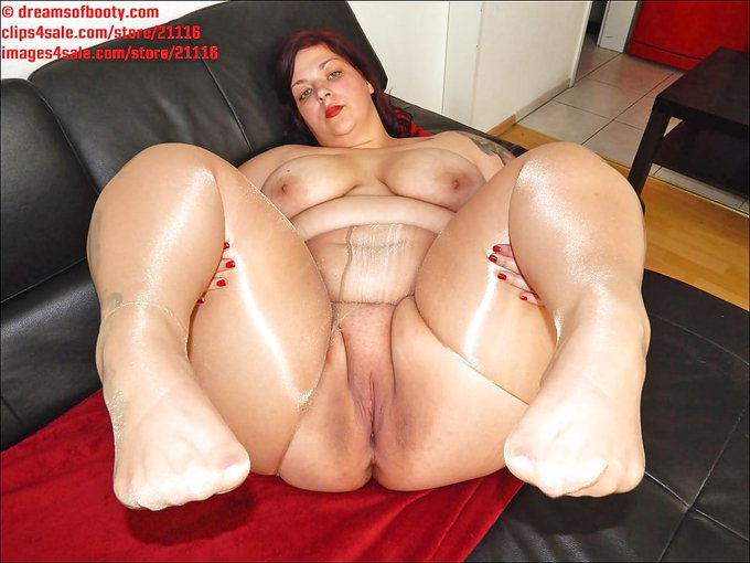 Sexy BBW in glossy tan tights showing pussy.