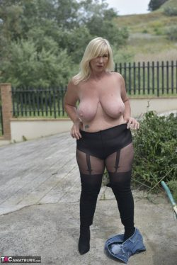 Large breasted mature in black fashion tights.