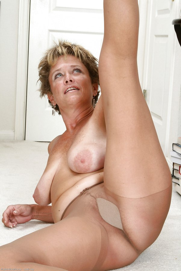 Sexy mature spreading and showing gusset in tan tights.